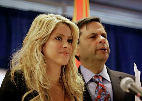 Colombian singer Shakira speaks to the media at Phoenix City Hall Thursday, April 29, 2010 with Phoenix Mayor Phil Gordon. The pop star was visiting Phoenix to voice her opposition to the new Arizona immigration law. Photo: AP