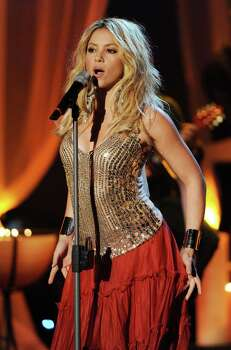 "Columbian singer Shakira performs on stage during the television show ""Wetten, dass..?"" (Let's Make a Bet) in the Austrian city of Salzburg on March 27, 2010.  AFP PHOTO POOL / TOBIAS HASE   GERMANY OUT Photo: TOBIAS HASE, AFP/Getty Images / 2010 AFP"