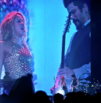 Shakira and her guitarists are projected on a large screen as they performed at the LEA Wednesday. Photo: Ricardo Segovia / LAREDO MORNING TIMES