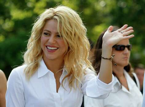 Colombian pop star Shakira waves to fans and friends after a news conference in Coral Gables, Fla., Monday, Aug. 1, 2011. Shakira announced an initiative between her Barefoot Foundation, or Pies Descalzos, and the Foundation FC Barcelona that includes the construction of sport and recreation facilities in the Colombian city of Cartagena, as well as in Miami. Photo: AP
