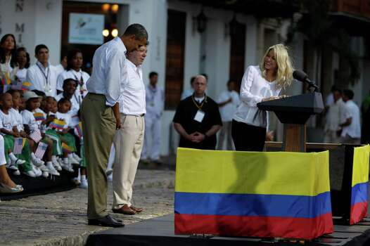 President Barack Obama, left, gestures to Colombia's pop star Shakira, right, as Colombia's President Juan Manuel Santos, center, looks on during a  land titling event for Afro-Colombian communities in Cartagena, Colombia, Sunday, April 15, 2012. Photo: AP