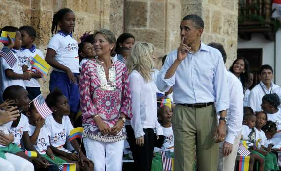 President Barack Obama gestures to children upon his arrival to a land titling event for Afro-Colombian communities at the San Pedro Claver square in Cartagena, Colombia, Sunday, April 15, 2012. At back are the wife of the president of Colombia, Maria Clemencia Rodriguez, left, and pop star Shakira, second from left. Photo: AP