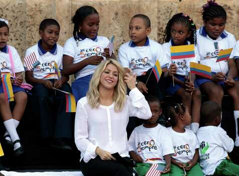 Colombia's pop star Shakira gestures during a land titling for Afro-Colombian communities event in Cartagena, Colombia, Sunday, April 15, 2012. Photo: AP