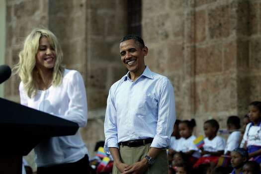 President Barack Obama, right, listens to Colombian singer Shakira during a land titling event for Afro-Colombian communities in Cartagena, Colombia, Sunday, April 15, 2012. Photo: AP