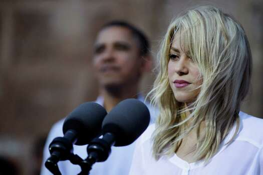 Colombian singer Shakira speaks as President Barack Obama, background, listens during a land titling event for Afro-Colombian communities in Cartagena, Colombia, Sunday, April 15, 2012. Photo: AP