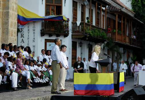 Colombia's pop star Shakira, right, delivers a speech as President Barack Obama, left, and Colombia's President Juan Manuel Santos listen during a land titling event for Afro-Colombian communities in Cartagena, Colombia, Sunday, April 15, 2012. Photo: AP