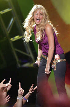 Recording artist Shakira of Colombia, smiles as she goes on stage Thursday, Oct. 21, 2004, at the 2004 MTV Latin Video Music Awards in Miami Beach, Fla. Photo: LUIS M. ALVAREZ, AP / AP