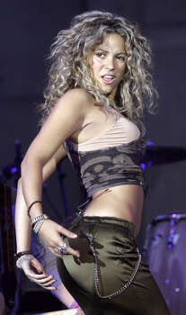 Colombian singer Shakira performs beneath the Puerta de Alcala monument in Madrid Sunday June 5, 2005, to promote the city's 2012 Olympic bid. The IOC will chose the host city for the 2012 Games on July 6 in Singapore. Madrid is up against Paris, New York, London and Moscow. Photo: PAUL WHITE, AP / AP