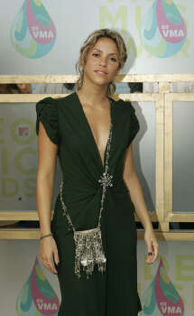 Shakira poses for photographers as she arrives on the white carpet of the 2005 MTV Video Music Awards Sunday, Aug. 28, 2005 at the American Airlines Arena in Miami. Photo: JEFF CHRISTENSEN, AP / AP