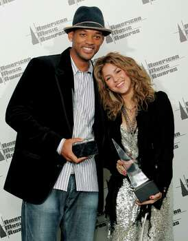 Will Smith, left, holds the award for favorite pop/rock male artist and Shakira holds the award ward for favorite latin music artist at the 33rd annual American Music Awards in Los Angeles on Tuesday, Nov. 22, 2005. Photo: KEVORK DJANSEZIAN, AP / AP