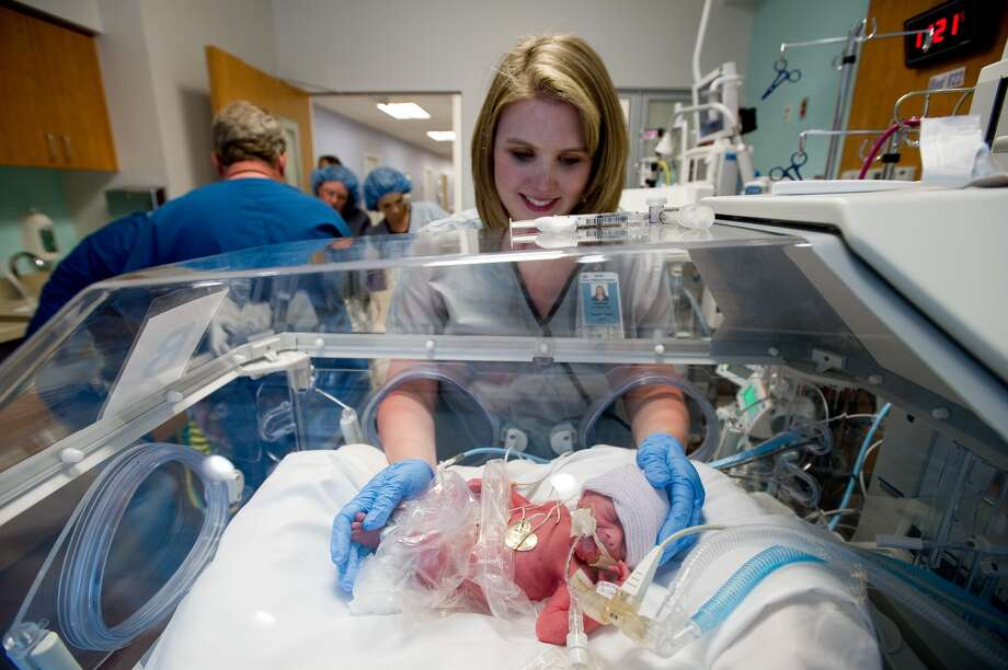 Nurse Morgan Pittman tends to one of the babies. (A. Kramer/Texas Children's Hospital)