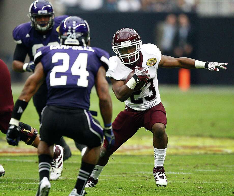 Ben Malena, who started for the injured Christine Michael and Cyrus Gray last season, has earned the praise of Kevin Sumlin for his work ethic. Photo: Bob Levey, Getty Images / 2011 Getty Images