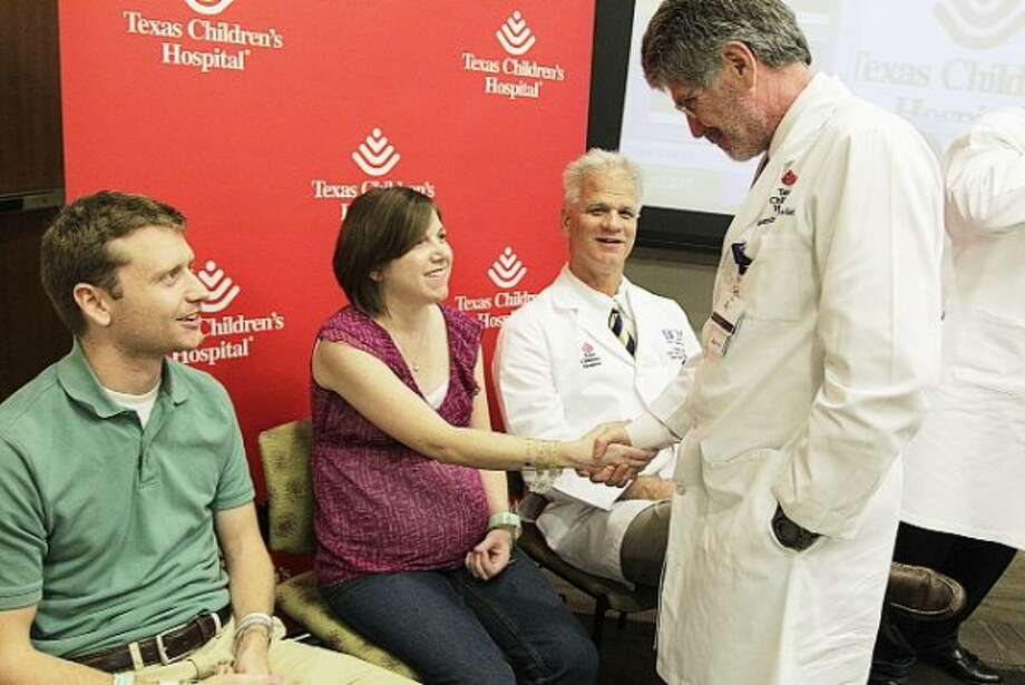 The parents of Houston sextuplets greet their doctors and the media on Wednesday. (Mayra Beltran / Houston Chronicle)
