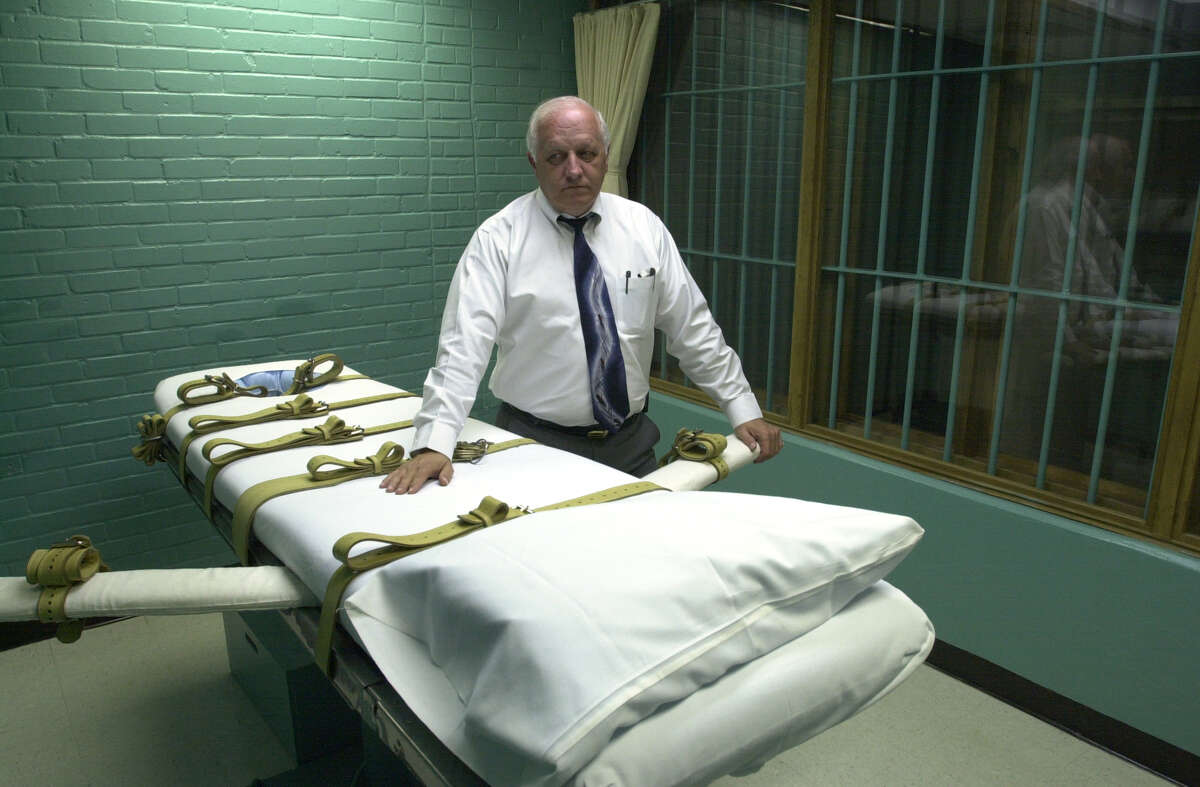 There is no evidence that the death penalty deters murders. Here, a warden in 2000 is shown with the gurney in Texas' death chamber in Huntsville.