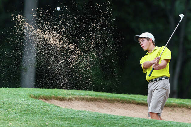Smithson Valley's Kirby Gorzell chips out of a bunker during the 4A state golf tournament at Jimmy Clay Golf Course in Austin on May 1, 2012.  Gorzell qualified for the tournament as a medalist and shot 152 (73-79). Photo: MARVIN PFEIFFER, Marvin Pfeiffer / Mpfeiffer@express-news.net / Express-News 2012