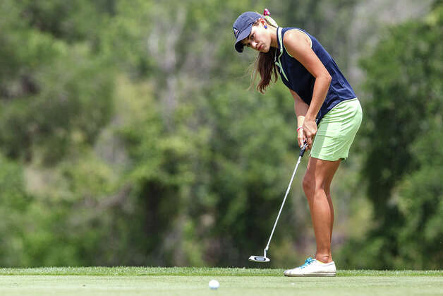 Smithson Valley's Megan Woods watchs her putt go towards the hole during the second day of the 4A state golf tournament at Jimmy Clay Golf Course in Austin on May 1, 2012.  Smithson Valley trailed  Montgomery A by only three strokes going into the second day but ended up finishing fourth in the tournament. Photo: MARVIN PFEIFFER, Marvin Pfeiffer / Mpfeiffer@express-news.net / Express-News 2012