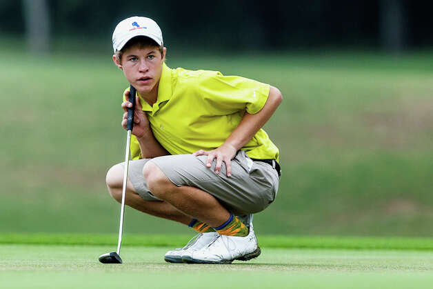 Smithson Valley's Kirby Gorzell checks a lie during the 4A state golf tournament at Jimmy Clay Golf Course in Austin on May 1, 2012.  Gorzell qualified for the tournament as a medalist and shot 152 (73-79). Photo: MARVIN PFEIFFER, Marvin Pfeiffer / Mpfeiffer@express-news.net / Express-News 2012