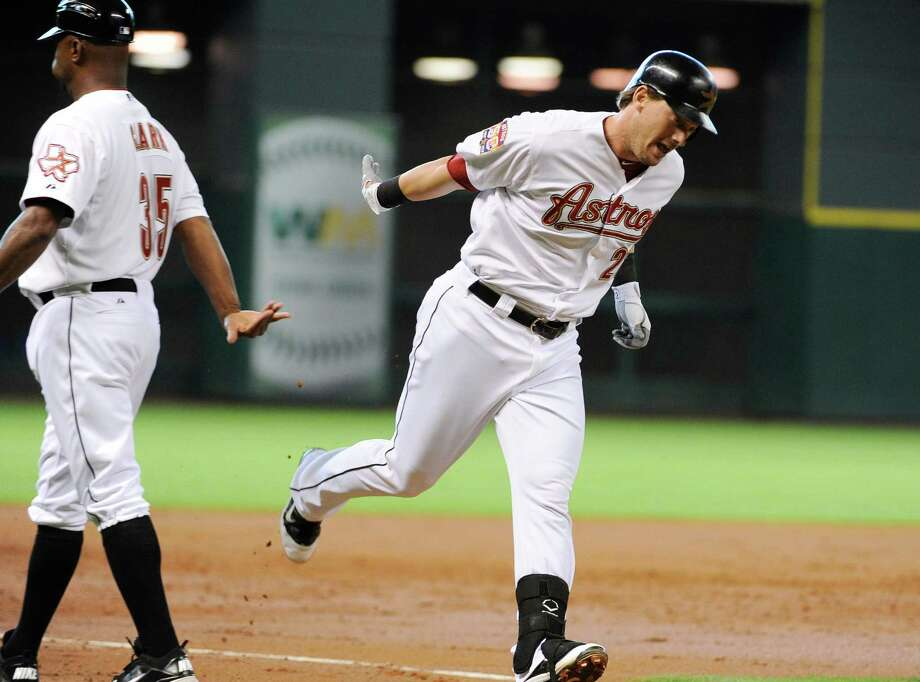 Houston Astros' Chris Johnson, right, rounds the bases past third base coach Dave Clark (35) after hitting a three-run home run against the New York Mets in the second inning of a baseball game, Wednesday, May 2, 2012, in Houston. (AP Photo/Pat Sullivan) Photo: Associated Press / AP