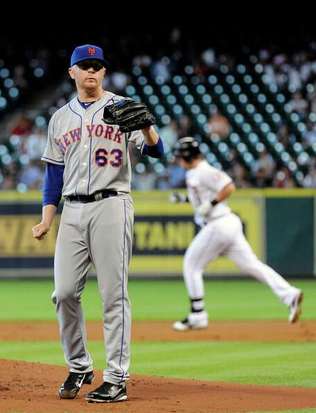 New York Mets pitcher Chris Schwinden (63) waits for a new ball as Houston Astros' Chris Johnson, ri