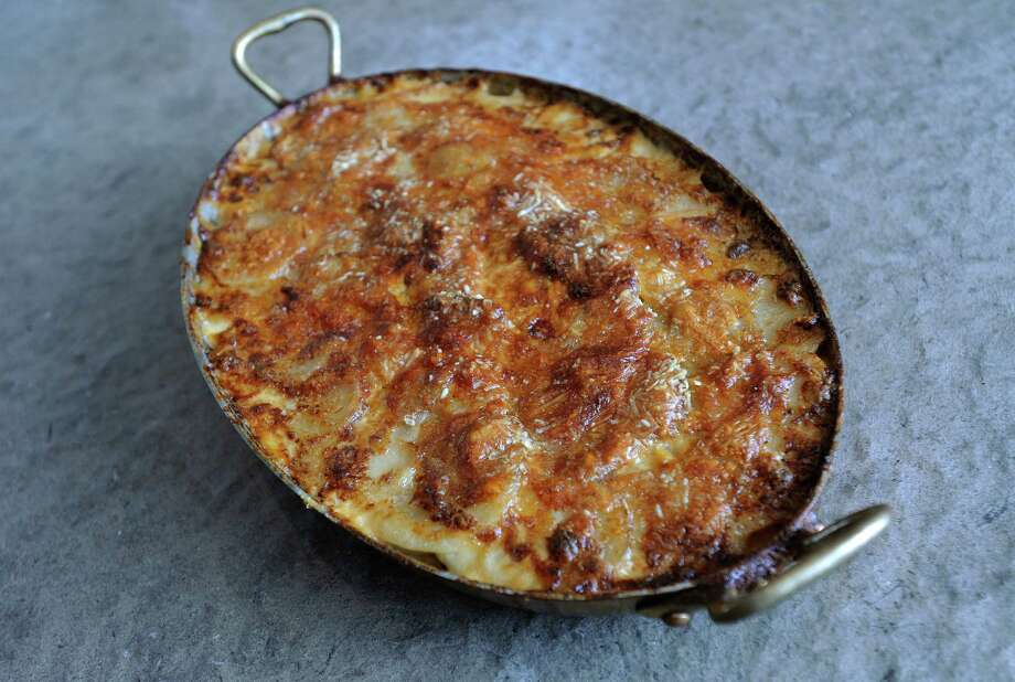 Potato gratin from Bistro Vitel, a dish favored by Express-News columnist Pat Mozersky. Photo: BILLY CALZADA, San Antonio Express-News / SAN ANTONIO EXPRESS-NEWS