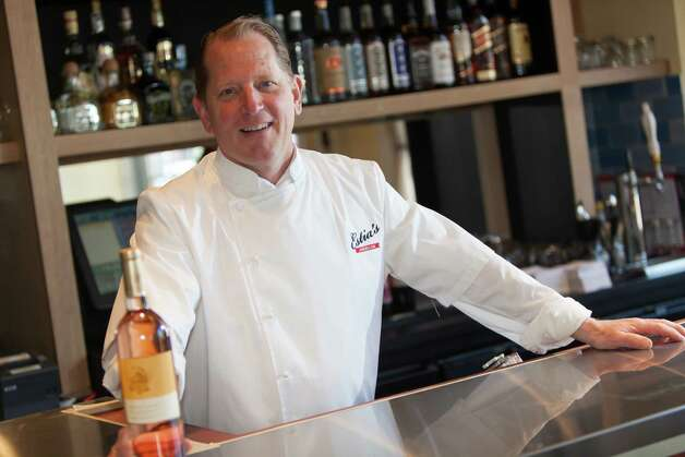 Colin Ambrose, chef/owner of Estia's American, poses behind the bar of his new restaurant. Photo courtesy of Thomas McGovern. Photo: Contributed Photo / CT