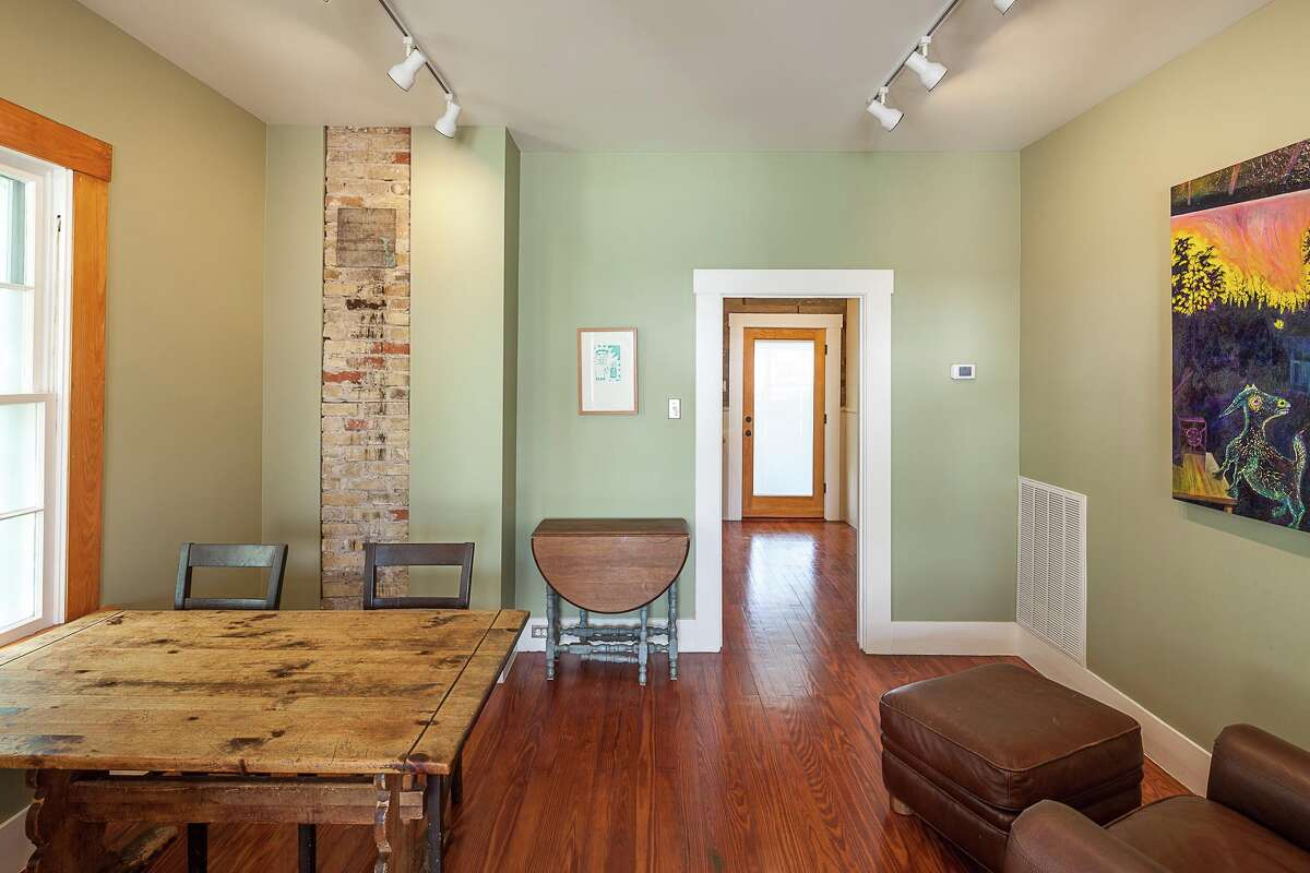 The home features artwork from Texas artists lit by the same-high efficacy LED bulbs that are throughout the house. The original brick chimney, previously covered, has been exposed.