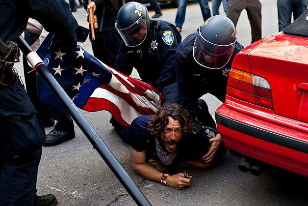 A protester is arrested on 14th Street during a May Day rally at Frank Ogawa Plaza May 1, 2012, in Oakland, Calif. Photo: Jason Henry, Special To The Chronicle