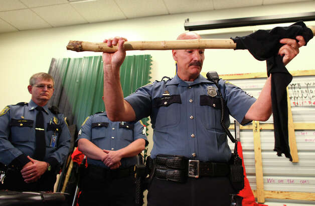 Seattle Police Sgt. Paul Gracy shows some of the items confiscated from protesters during a press conference showing some of the weapons confiscated during a May Day march the previous day. The press conference was on Wednesday, May 2, 2012 at the Seattle Police Department's West Precinct. Photo: JOSHUA TRUJILLO / SEATTLEPI.COM