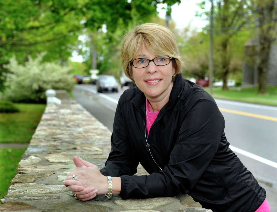 Beth Munnelly, a breast and thyroid cancer survivor, who will be running in Ridgefield's annual Run Like a Mother Race, is photographed Wednesday, May 2, 2012. Photo: Carol Kaliff