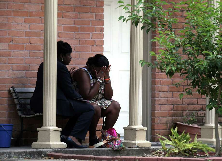 A mother reacts while speaking with HPD Homicide Sgt. Ora Chandler, left, as police investigate the death of her near 6-month-old son who was found in the refrigerator by firefighters where he lived with his father at The University Apartments on the 7100 block of Beechnut Wednesday, May 2, 2012, in Houston.  Investigators say the baby's father called 911 this morning, saying he was suicidal. When rescue personnel arrived at the apartment around 7:40 a.m. no one opened the door. Neighbors told firefighters that a baby was in the apartment. Fearing for the child's safety, firefighters broke into the unit and found the father collapsed on the floor. He was incoherent and said he had killed his son, police said. The baby was found wrapped in a blanket, dead in refrigerator. The father, who has not been identified, became violent and had to be subdued. He was taken to a hospital where he remains. Photo: Johnny Hanson, Houston Chronicle / © 2012  Houston Chronicle