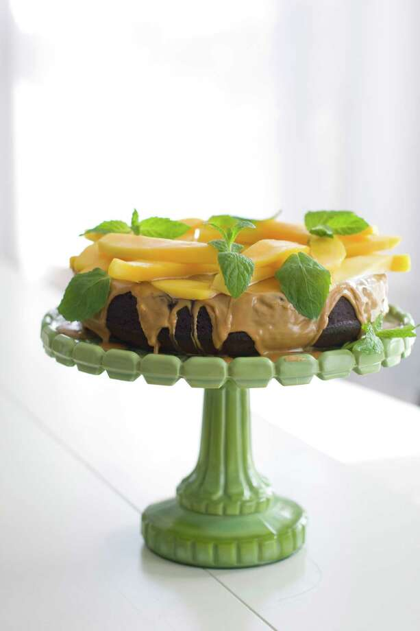 In this image taken on March 26, 2012 a mango-topped chocolate honey cake is seen in Concord, N.H. (AP Photo/Matthew Mead) Photo: Matthew Mead