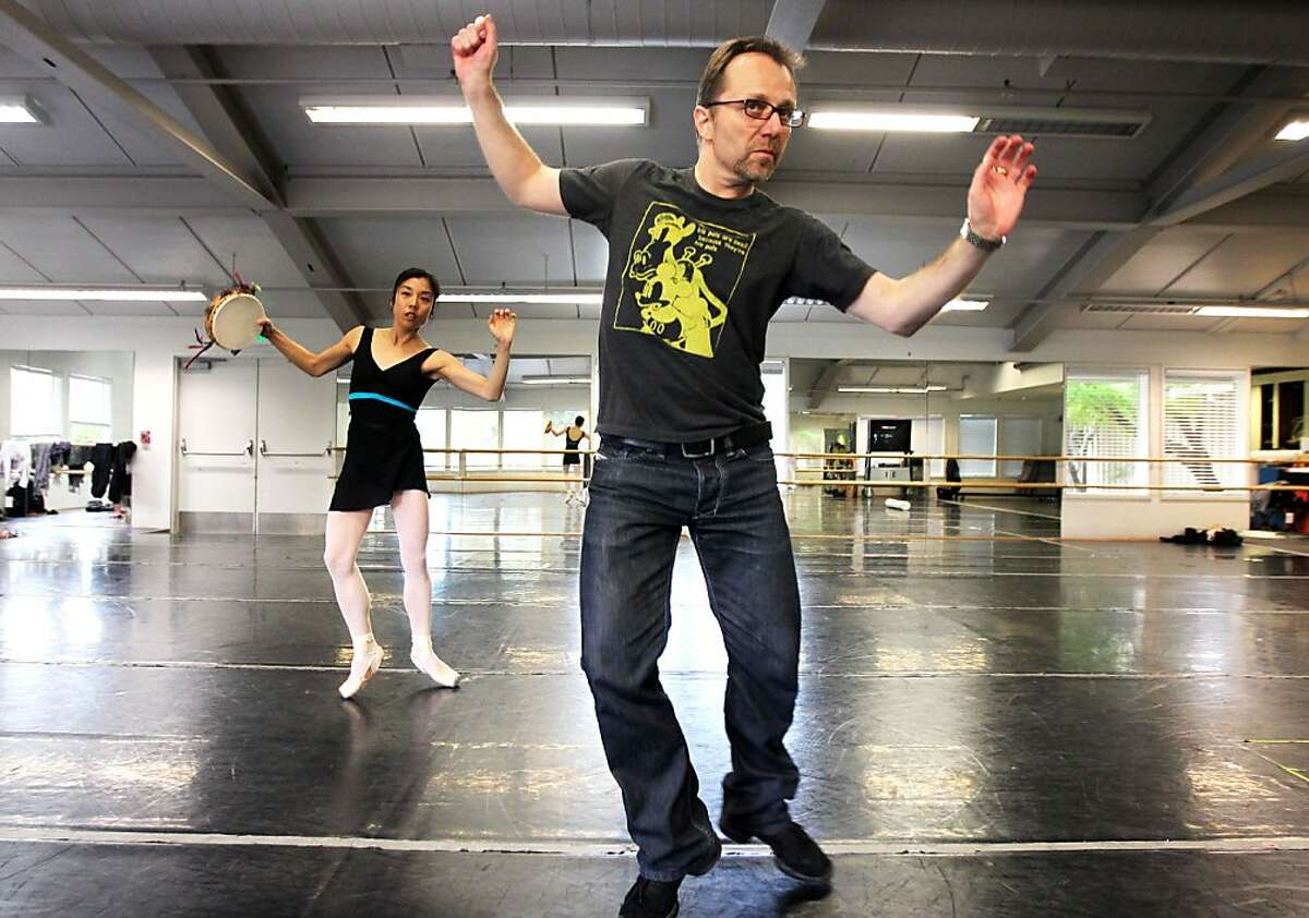 Christopher Stowell, Artistic Director of the Oregon Ballet Theater, gives direction to Hiromi Yamazaki during a rehearsal, as Stowell begins arranging George Balanchine's