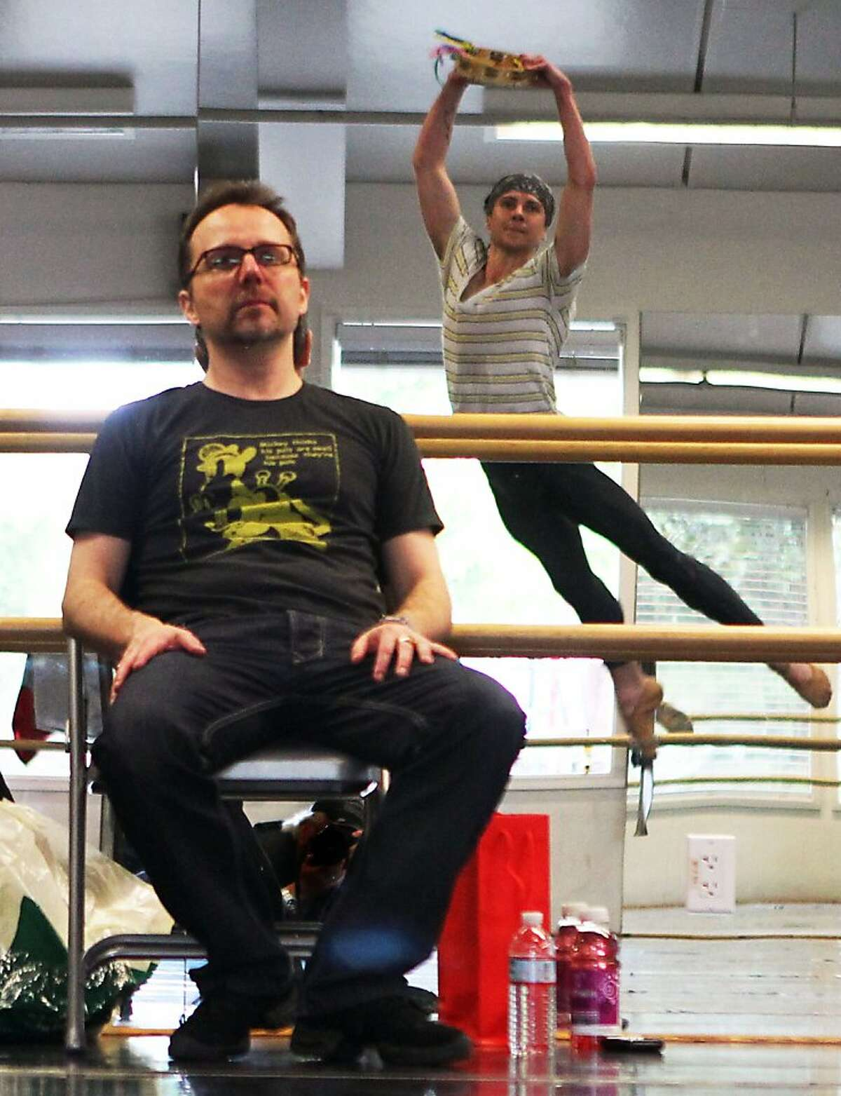 Christopher Stowell, Artistic Director of the Oregon Ballet Theater, gives direction to Robert Dekkers during a rehearsal, as Stowell begins arranging George Balanchine's