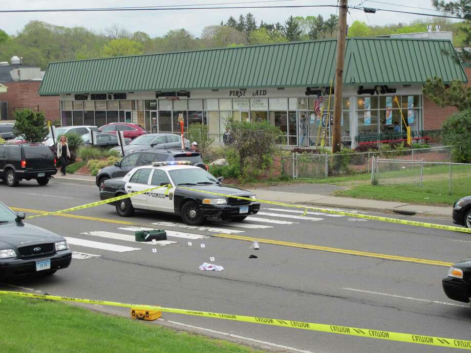 A pedestrian was struck by a car on White Plains Road in Trumbull, Conn. on May 2, 2012 in front of the Trumbull Congregational Church. Photo: Tom Cleary