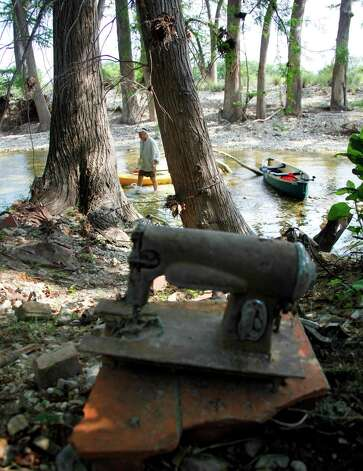 An old sewing machine sits on the riverbank. A continuing drought has dropped the river's level, including in nearby Bandera, where the Medina was flowing at 22 cubic feet per second Wednesday. The river usually flows at 77 cfs. Photo: William Luther, San Antonio Express-News / © 2012 WILLIAM LUTHER