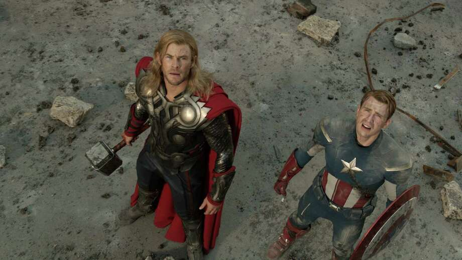 Chris Hemsworth, left, reprises his role as Thor and Chris Evans returns as Captain America in the action-adventure film based on Marvel comics.