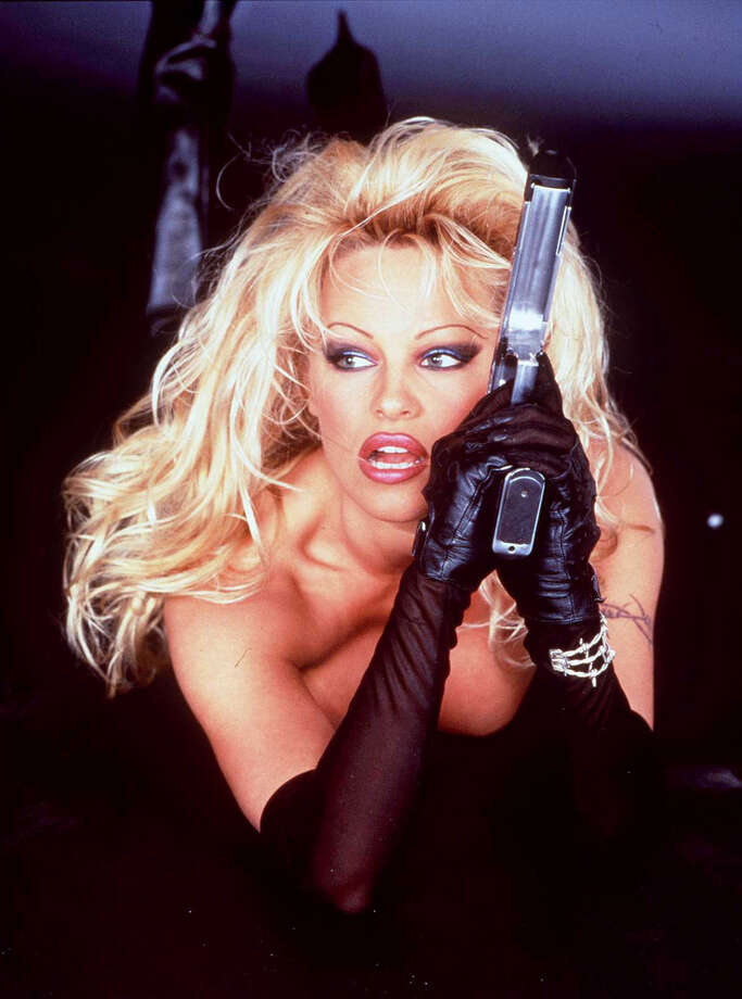 "In 1995, while still being taken semi-seriously as an actress, former Playmate of the Year Pamela Anderson played the title role in the film ""Barb Wire."" She had no special powers, other than being a badass fighter and irresistible to a certain kind of man. It's generally considered one of the worst films of the decade. Photo: Getty Images / Getty Images North America"