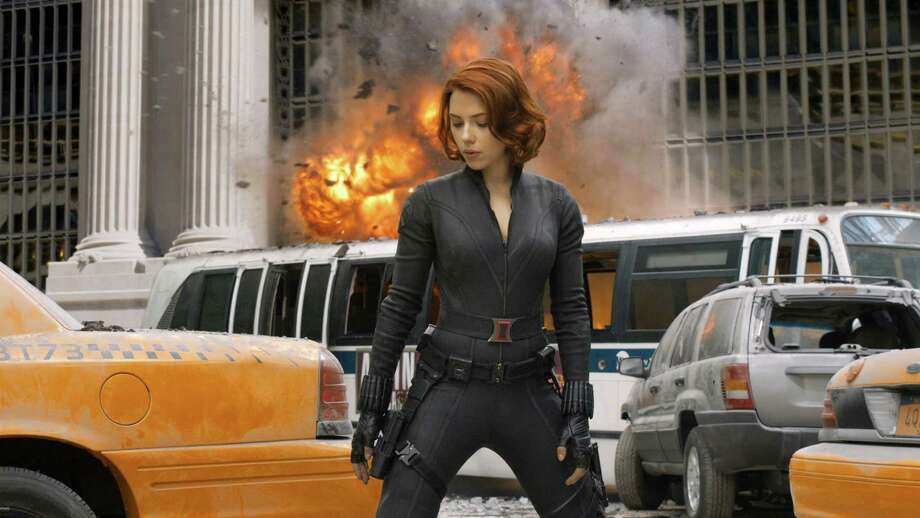 """Scarlett Johansson plays Natasha Romanoff, aka Black Widow, in """"The Avengers,"""" which opened last Friday to great anticipation and proved to be one of the biggest box-office openings in film history. She's the latest in a long line of fantasy females to be translated from comics and video games to TV and movie screens. Photo: Paramount Pictures / © 2011 MVLFFLLC.  TM & © 2011 Marvel.  All Rights Reserved."""