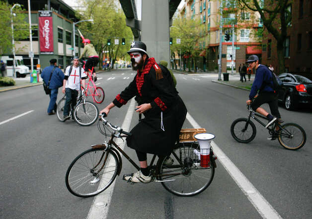 A protestor rides his bike during a May Day rally in downtown Seattle on Tuesday, May 1, 2012. Photo: SOFIA JARAMILLO / SEATTLEPI.COM