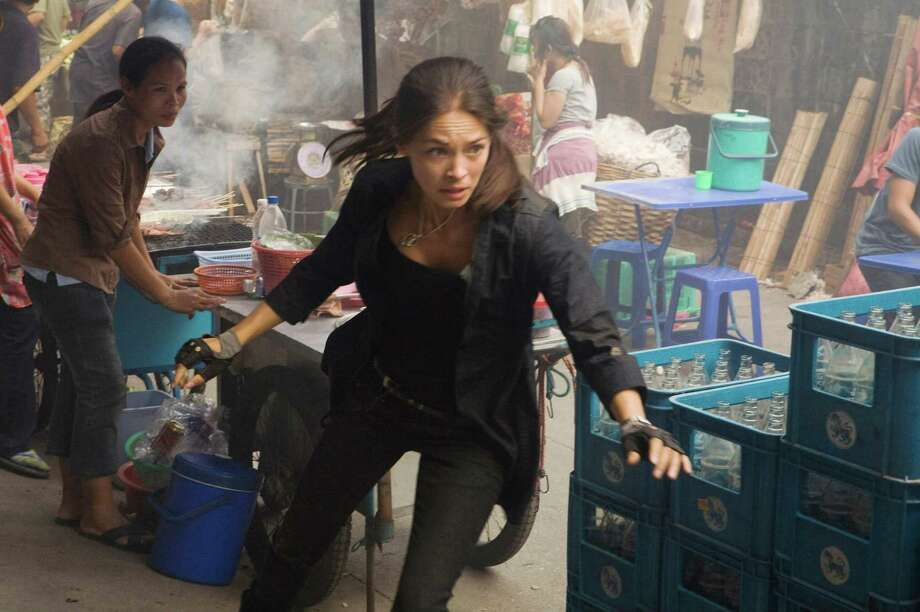 """Street Fighter"" hit the big screen again in 2009's  ""Street Fighter: The Legend of Chun-Li."" Kristin Kreuk played longtime female fighter Chun-Li. Photo: Photo Credit: Patrick Brown, Twentieth Century Fox / TM and © 2009 Capcom Co., LTD. All rights reserved. Not for sale or duplication."
