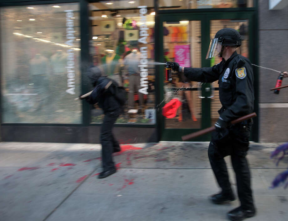 A protestor is pepper sprayed while vandalizing American Apparel. Photo: SOFIA JARAMILLO / SEATTLEPI.COM