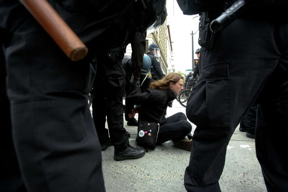 A protestor is arrested during the May Day rally in Westlake Park. Photo: SOFIA JARAMILLO / SEATTLEPI.COM