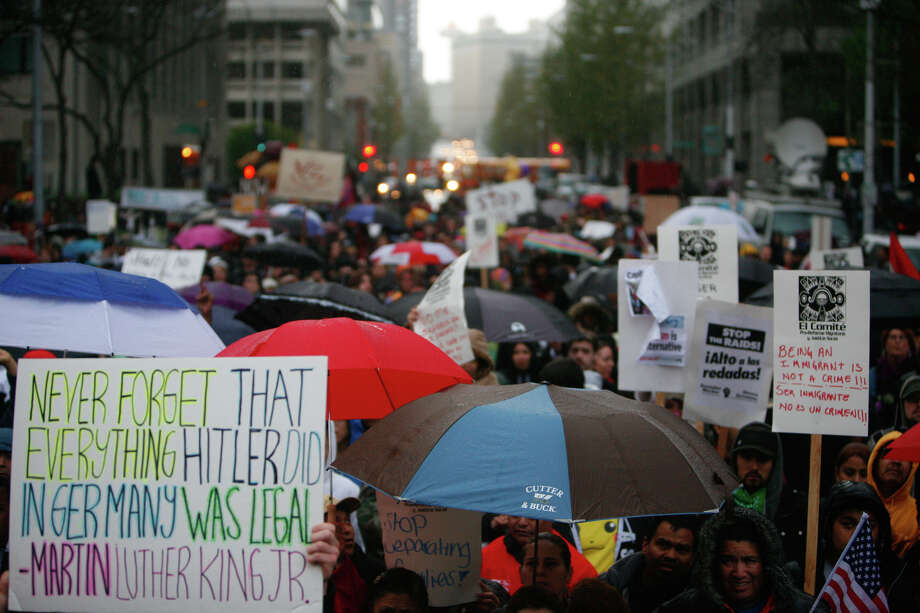 Hundreds gathered in the rain for a May Day immigrant rights rally in downtown Seattle on Tuesday, May 1, 2012. Photo: SOFIA JARAMILLO / SEATTLEPI.COM