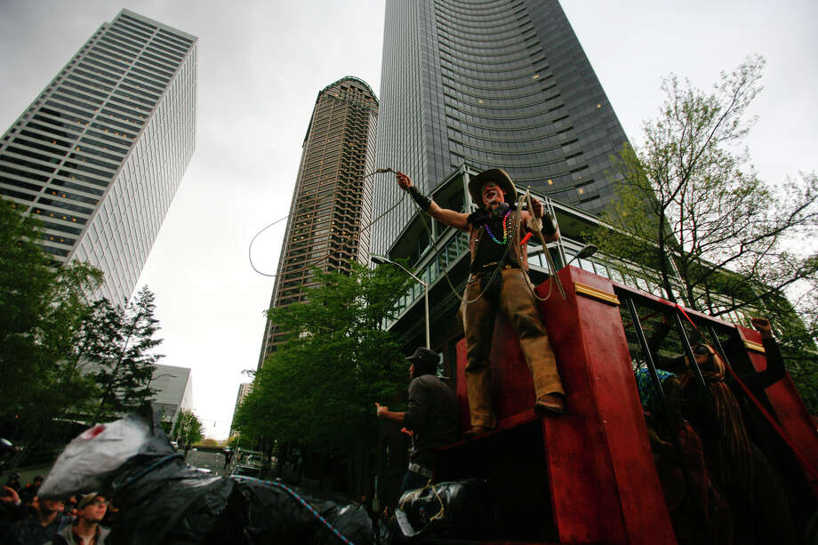 A protester dressed as a cowboy rides a float in the immigrant rights May Day march. Photo: SOFIA JARAMILLO / SEATTLEPI.COM