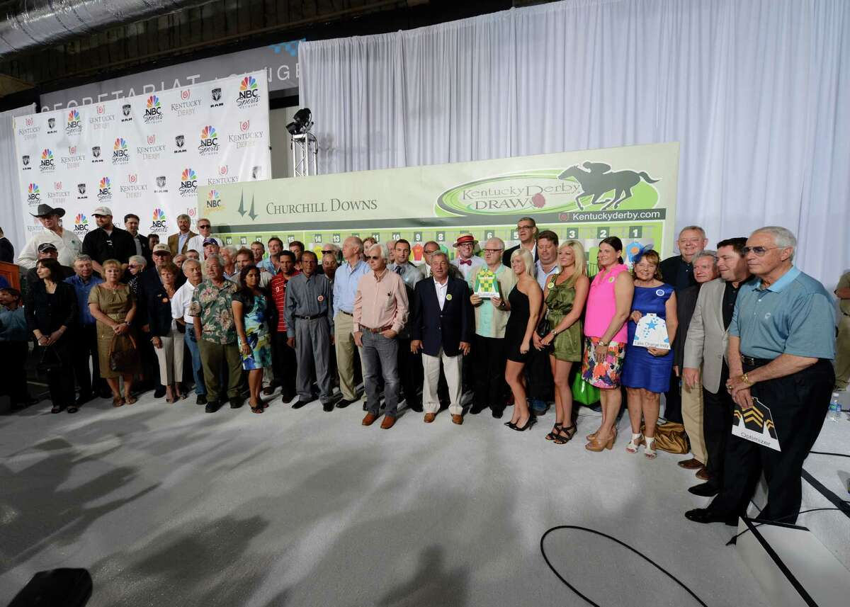 Connections for the horses in the 138th running of the Kentucky Derby stand in front of their respective post positions after the Official Post Position Draw at Churchill Downs in Louisville, KY May 2, 2012.(Skip Dickstein / Times Union)