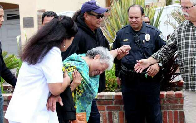 OCEANSIDE, CA - MAY 2:  Luisa Seau (C), the mother of Junior Seau who was found dead, weeps with friends and family members at the former linebacker's beach home May 2, 2012 in Oceanside, California. Seau, who played for various NFL teams including the San Diego Chargers, Miami Dolphins and New England Patriots was found dead by his girlfriend in his home with a gunshot wound to his chest in an apparent suicide. Photo: Sandy Huffaker, . / 2012 Getty Images