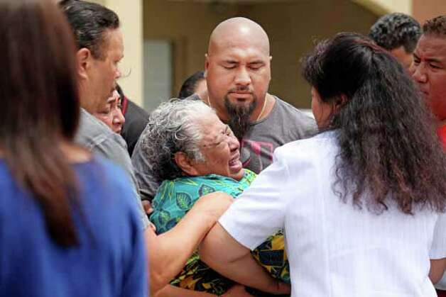 OCEANSIDE, CA - MAY 2:  Luisa Seau , the mother of Junior Seau who was found dead, weeps with friends and family members at the former linebacker's beach home May 2, 2012 in Oceanside, California. Seau, who played for various NFL teams including the Chargers, Dolphins and Patriots was found dead by his girlfriend with a gunshot wound to his chest in his home in an apparent suicide. Photo: Sandy Huffaker, . / 2012 Getty Images