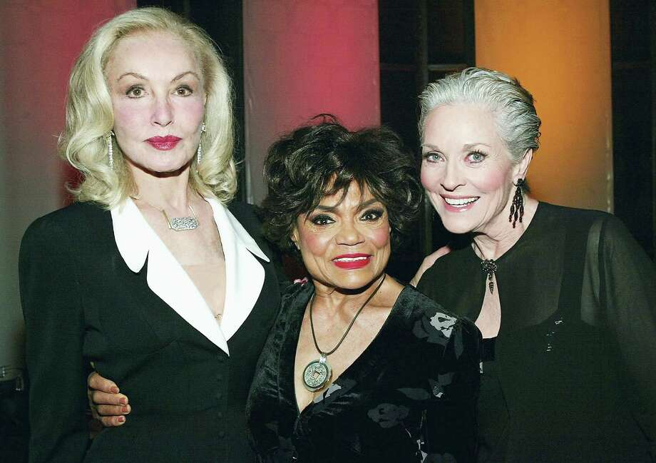Perhaps the most frequently played character in the world of superheroines is Catwoman. Here, seen at a TV Land event in 2004, are the three actresses who played her in the 1960s TV series. From left, Julie Newmar, Eartha Kitt and Lee Meriwether. Photo: Frank Micelotta, Getty Images / 2004 Getty Images
