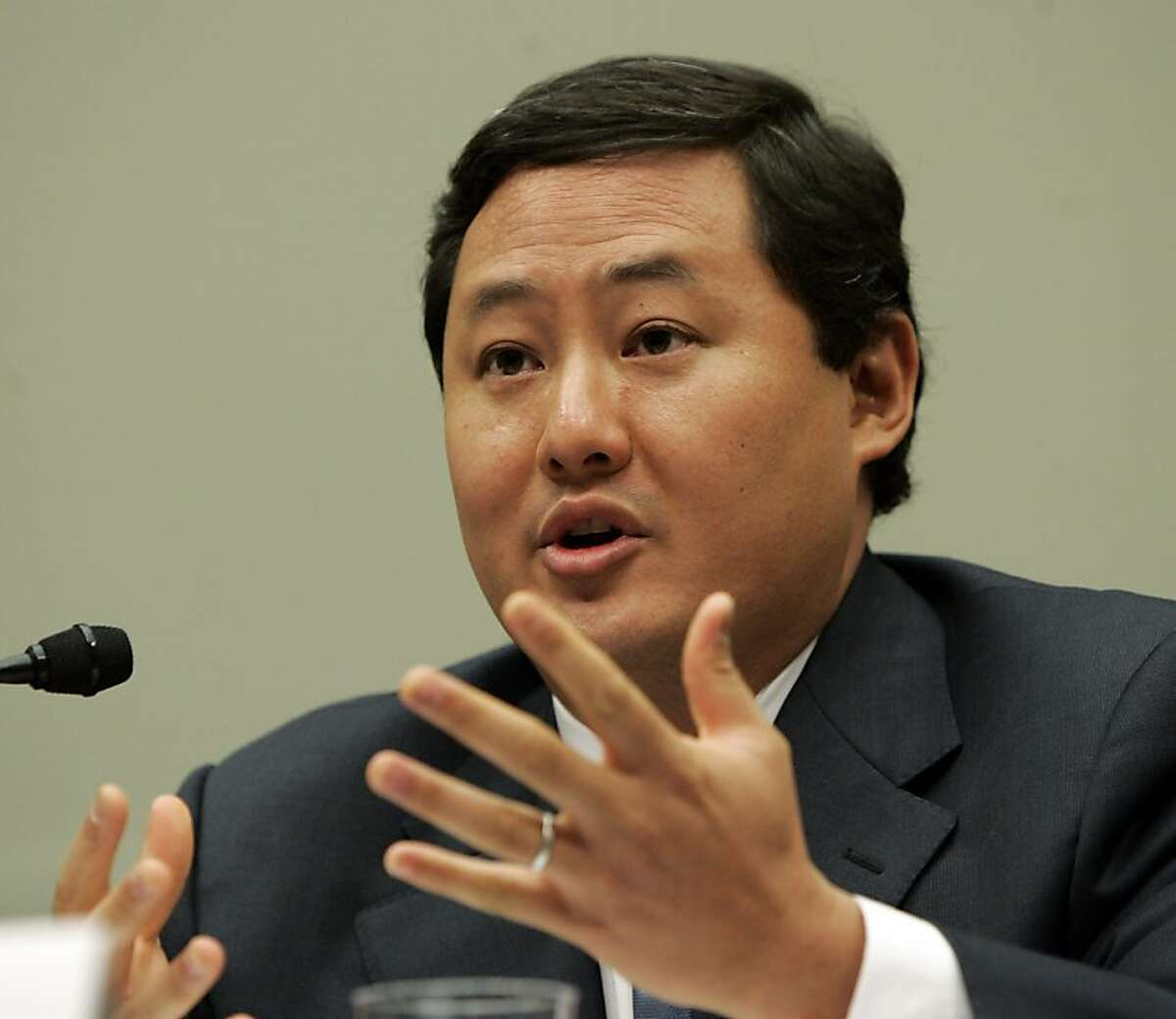 In this June 26, 2008 file photo John Yoo, a law professor at the University of California at Berkeley, testifies on Capitol Hill in Washington. Justice Department officials have stopped short of recommending criminal charges against Bush administration lawyers who wrote secret memos approving harsh interrogation techniques of terror suspects. (AP Photo/Susan Walsh, File)