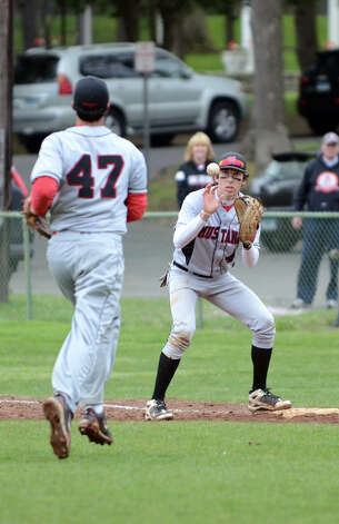Fairfield Warde's Dan Warren (47) makes a play to first baseman Matt McTague (4) during the baseball game against New Canaan at Mead Park in New Canaan on Wednesday, May 2, 2012. Photo: Amy Mortensen / Connecticut Post Freelance